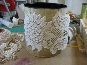 Hot glue a doily to the front of the can